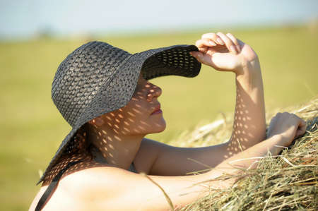 Woman in a big hat  Stock Photo - 15646564