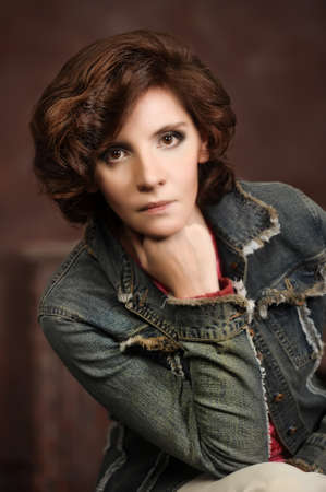 portrait of a woman in a denim jacket photo