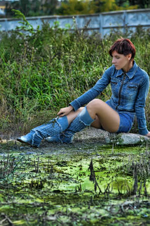 girl in a denim jacket and shorts Stock Photo - 15646577