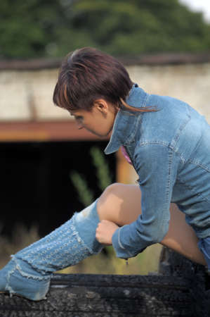 girl in a denim jacket and shorts Stock Photo - 15646579