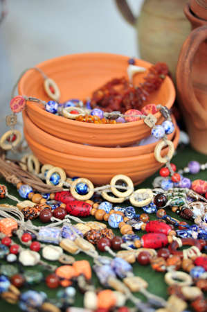 Clay bowls and bright ceramic beads of handwork  photo