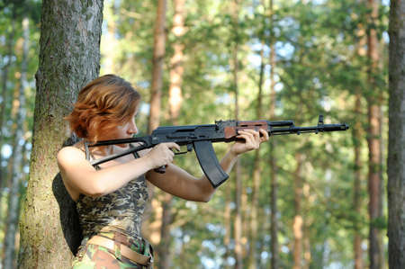 airsoft: woman with a gun