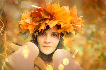 Woman in maple wreath Stock Photo - 15801179