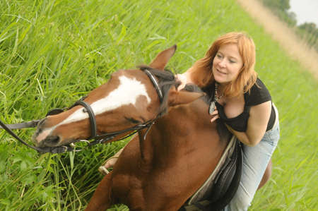 horse laugh: Woman   Horse in field or park  Stock Photo