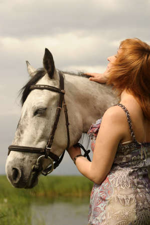 dutch girl: Woman   Horse in field or park  Stock Photo