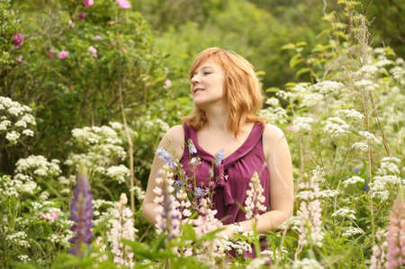 Happy woman in garden with flowers  photo