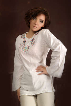 chemise: young woman in a white shirt with embroidery