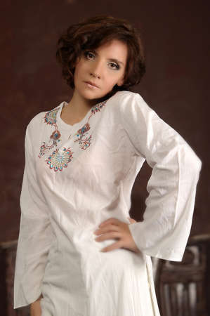 young woman in a white shirt with embroidery photo