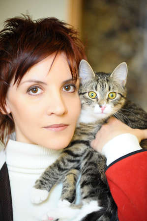 Portrait of fashion woman with cat  photo
