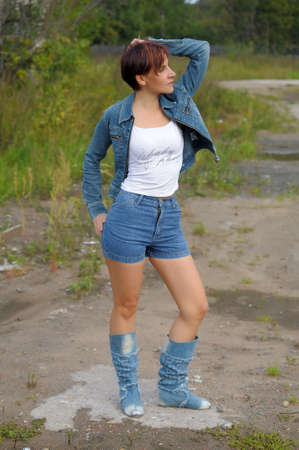 girl in a denim jacket and shorts Stock Photo - 15809329