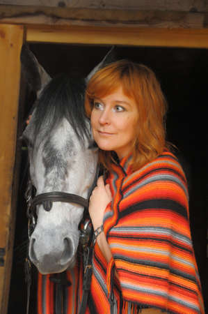 barn black and white: a woman with a horse