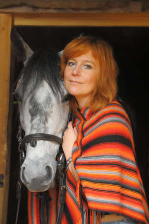 a woman with a horse Stock Photo - 15803261