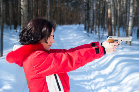 Winter girl with gun Stock Photo - 15801136