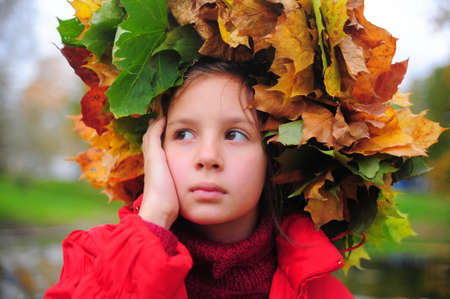 Girl in a yellow head wreath  photo