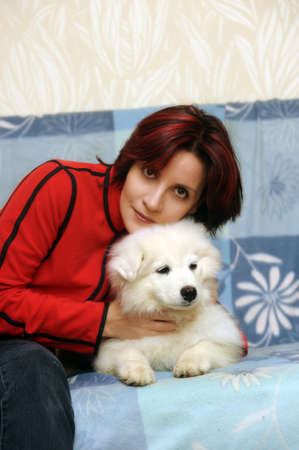 young woman with a puppy Samoyed photo