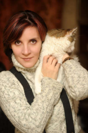 Young woman with a cat in her arms Stock Photo - 16010628