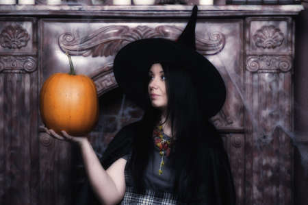 Witch with pumpkin Stock Photo - 19000510