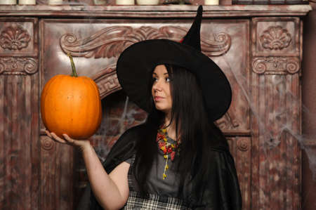 Witch with pumpkin Stock Photo - 19000504