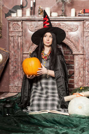 Witch with pumpkin photo