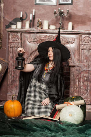 Witch with pumpkin Stock Photo - 19000515