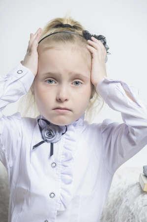 schoolgirl girl clutching his head Stock Photo - 18160856