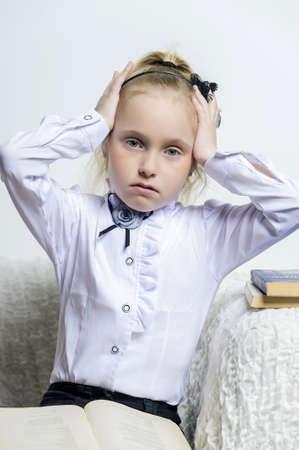 schoolgirl girl clutching his head Stock Photo - 18160859