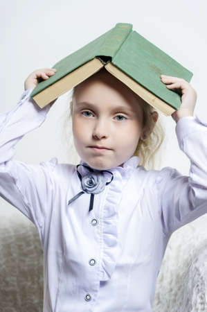 schoolgirl girl with a book on her head Stock Photo - 18160862