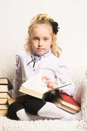 sad girl schoolgirl with books photo