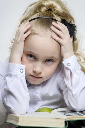 clutching: schoolgirl girl clutching his head Stock Photo