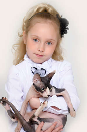 Little girl with cat pet Stock Photo - 17158235