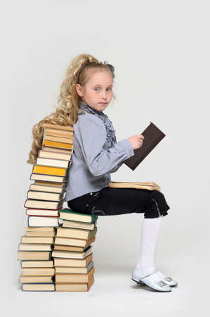 girl schoolgirl with a stack of books Stock Photo - 16220450