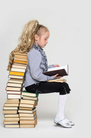 educations: girl schoolgirl with a stack of books
