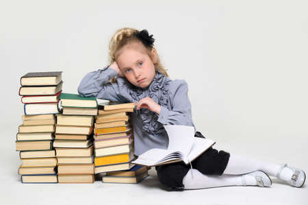 girl schoolgirl with a stack of books Stock Photo - 16220447