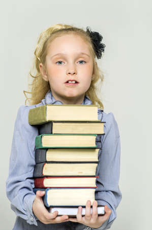 girl schoolgirl with a stack of books Stock Photo - 16220387
