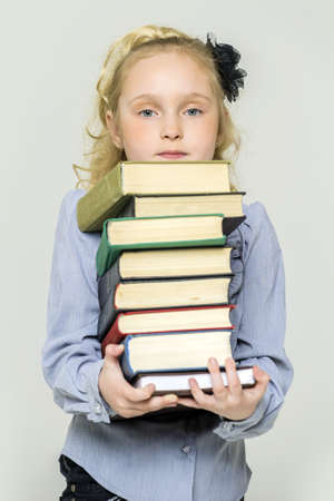 girl schoolgirl with a stack of books Stock Photo - 16220393