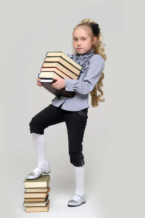 girl schoolgirl with a stack of books Stock Photo - 16220452