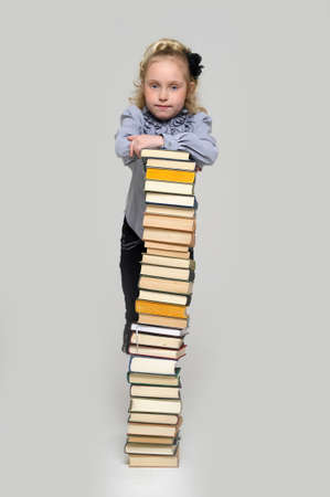 girl schoolgirl with a stack of books Stock Photo - 16220451