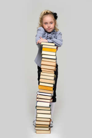 girl schoolgirl with a stack of books photo