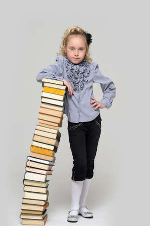 girl schoolgirl with a stack of books Stock Photo - 16220437