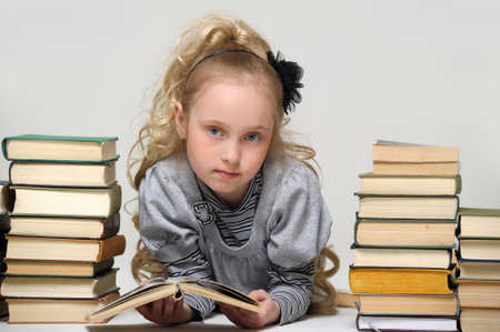 girl schoolgirl with a stack of books Stock Photo - 16220394