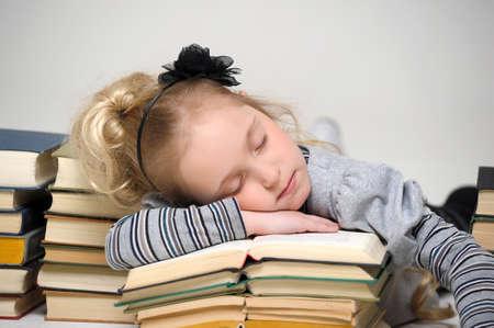 Girl asleep on the books  photo