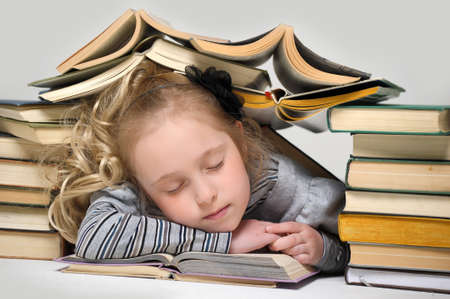 Girl asleep on the books  Stock Photo - 16194304