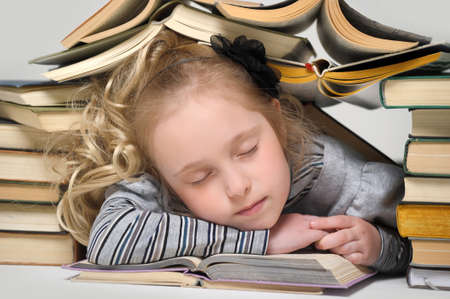 Girl asleep on the books  photo