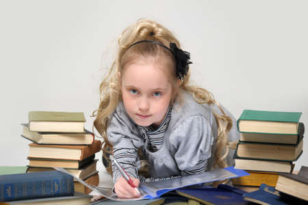 prodigy: girl schoolgirl with a stack of books