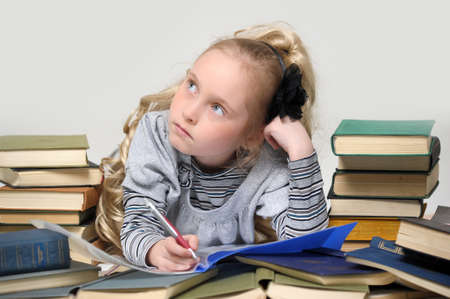 girl schoolgirl with a stack of books Stock Photo - 16212732