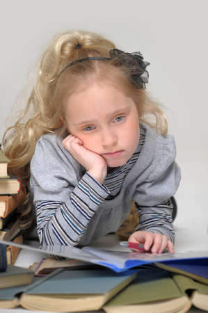 sad girl with books photo
