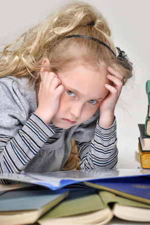 sad girl with books Stock Photo - 16847160