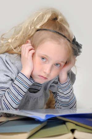 sad girl with books Stock Photo - 16847157
