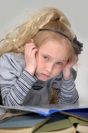 studding: sad girl with books Stock Photo