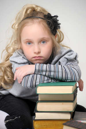 schoolgirl girl with a books photo